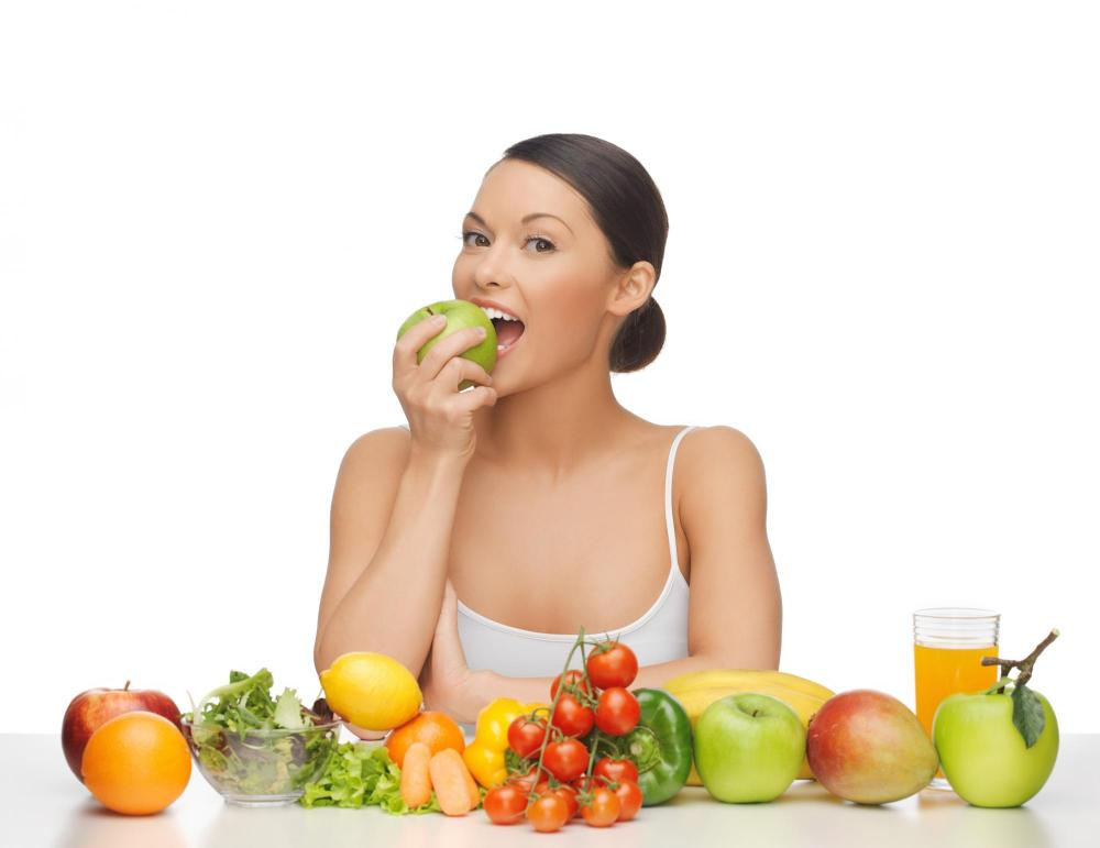 woman eating fruit and vegetables